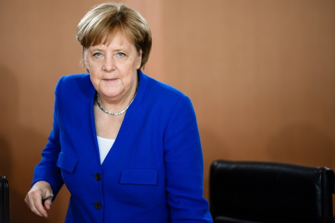 epa06879739 German Chancellor Angela Merkel arrives for the beginning of the weekly cabinet meeting in Berlin, Germany, 11 July 2018. During the 17th cabinet meeting, the ministers and the Chancellor are expected to discuss, among others, a draft law on an international agreement on the secure and environment friendly recycling of ships.  EPA/CLEMENS BILAN