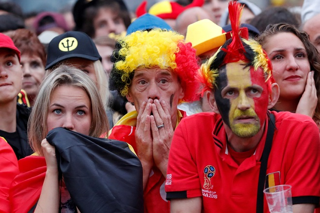 Soccer Football - World Cup - Semi-Final - France v Belgium - Brussels, Belgium - July 10, 2018. Belgium fans react as they watch the broadcast of the World Cup semi-final match between France and Belgium in the fan zone. REUTERS/Yves Herman     TPX IMAGES OF THE DAY - RC11CA37CE60