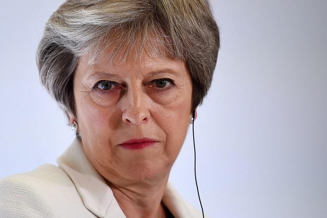 epa06878510 British Prime Minister Theresa May during a press conference at the Western Balkans Summit at Lancaster House in London, Britain, 10 July 2018. Britain is hosting the Western Balkans Summit in London 10 July.  EPA/ANDY RAIN