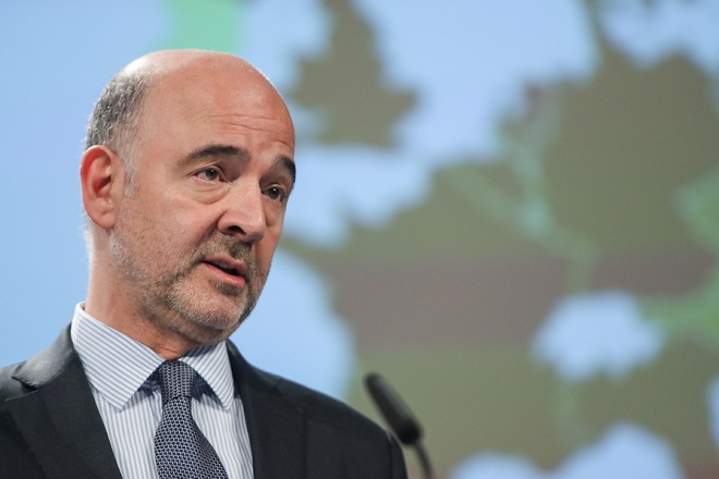 epa06882978 European Commissioner for Economic and Financial Affairs, Pierre Moscovici gives a press conference on the Summer Interim Forecast 2018 at the European Commission in Brussels, Belgium, 12 July 2018.  EPA/STEPHANIE LECOCQ