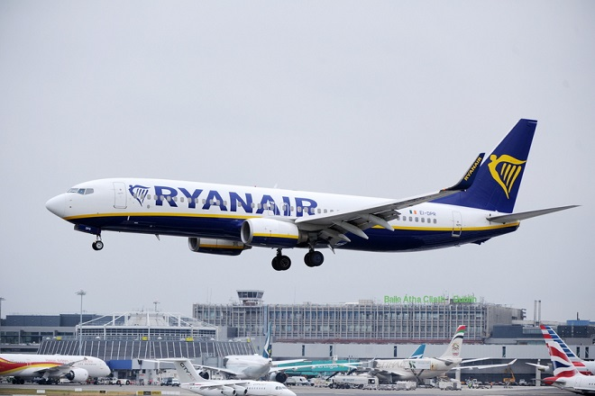 epa06883127 A Ryanair aircraft landing at Dublin airport, Dublin, Ireland 12 July 2018. Reports state that Ryanair has cancelled 30 flights  between Ireland and Britain on 12 July 2018 after the Irish Airline Pilots' Association voted to strike last week.  EPA/STR