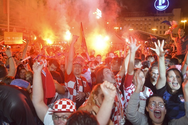 epa06882370 Supporters of Croatia celebrate as they watch the broadcast of the FIFA World Cup 2018 semi final match between Croatia and England in central Zagreb, Croatia, 11 July 2018. Croatia won 2-1.  EPA/STR