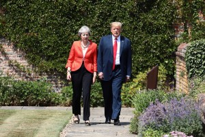epa06885731 British Prime Minister Theresa May (L) walks with US President Donald J. Trump (R) after their bilateral meeting at Chequers in Aylesbury, Britain, 13 July 2018. US President Trump is on a three-day working visit to the United Kingdom, first trip to the country as US president.  EPA/JACK TAYLOR / POOL