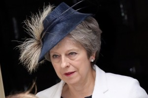 epa06877415 British Prime Minister Theresa May leaves 10 Downing Street, central London, Britain, 10 July 2018, to attend the Royal Air Forces 100th anniversary, following a Cabinet meeting. The Cabinet met a day after Foreign Secretary Boris Johnson resigned and British Prime Minister Theresa May attended a meeting of the 1922 committee of Cosnervative Members of Parliament.  EPA/SEAN DEMPSEY