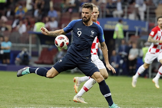 epa06891009 Olivier Giroud of France in action during the FIFA World Cup 2018 final between France and Croatia in Moscow, Russia, 15 July 2018.  (RESTRICTIONS APPLY: Editorial Use Only, not used in association with any commercial entity - Images must not be used in any form of alert service or push service of any kind including via mobile alert services, downloads to mobile devices or MMS messaging - Images must appear as still images and must not emulate match action video footage - No alteration is made to, and no text or image is superimposed over, any published image which: (a) intentionally obscures or removes a sponsor identification image; or (b) adds or overlays the commercial identification of any third party which is not officially associated with the FIFA World Cup)  EPA/YURI KOCHETKOV   EDITORIAL USE ONLY