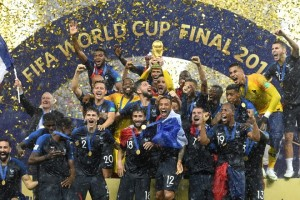 epaselect epa06891475 French player react with the trophy after winning the FIFA World Cup 2018 final between France and Croatia in Moscow, Russia, 15 July 2018.  (RESTRICTIONS APPLY: Editorial Use Only, not used in association with any commercial entity - Images must not be used in any form of alert service or push service of any kind including via mobile alert services, downloads to mobile devices or MMS messaging - Images must appear as still images and must not emulate match action video footage - No alteration is made to, and no text or image is superimposed over, any published image which: (a) intentionally obscures or removes a sponsor identification image; or (b) adds or overlays the commercial identification of any third party which is not officially associated with the FIFA World Cup)  EPA/FACUNDO ARRIZABALAGA   EDITORIAL USE ONLY