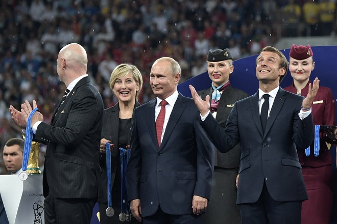 epa06891971 FIFA President Gianni Infantino (L), Russian President Vladimir Putin (C) and French President Emmanuel Macron (R) attend the award ceremony after the FIFA World Cup 2018 final between France and Croatia in Moscow, Russia, 15 July 2018. (RESTRICTIONS APPLY: Editorial Use Only, not used in association with any commercial entity - Images must not be used in any form of alert service or push service of any kind including via mobile alert services, downloads to mobile devices or MMS messaging - Images must appear as still images and must not emulate match action video footage - No alteration is made to, and no text or image is superimposed over, any published image which: (a) intentionally obscures or removes a sponsor identification image; or (b) adds or overlays the commercial identification of any third party which is not officially associated with the FIFA World Cup)  EPA/ALEXEI NIKOLSKY / SPUTNIK  / KREMLIN POOL / POOL MANDATORY CREDIT