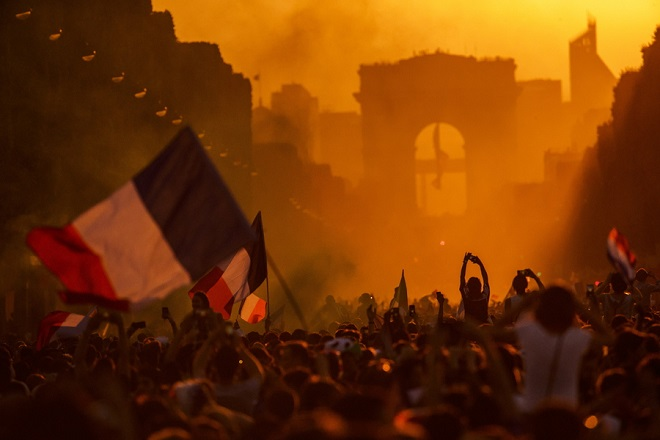 epa06892069 French supporters celebrate on the Champs Elysees their team's victory after the FIFA World Cup 2018 final match between France and Croatia in Paris, France, 15 July 2018. France won 4-2.  EPA/CHRISTOPHE PETIT TESSON