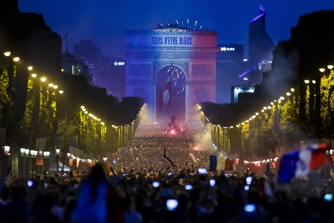 epa06892091 French supporters celebrate on the Champs Elysees their team's victory after the FIFA World Cup 2018 final match between France and Croatia in Paris, France, 15 July 2018. France won 4-2.  EPA/CHRISTOPHE PETIT TESSON