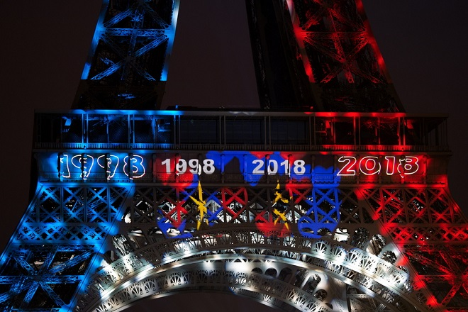 epa06892161 The Eiffel Tower illuminated with blue, white, red is reflected on the surface of the Seine in Paris, after the victory of the French Football Team against Croatia in FIFA World Cup 2018 final soccer match between in Paris, France, 15 July 2018.  EPA/CAROLINE BLUMBERG