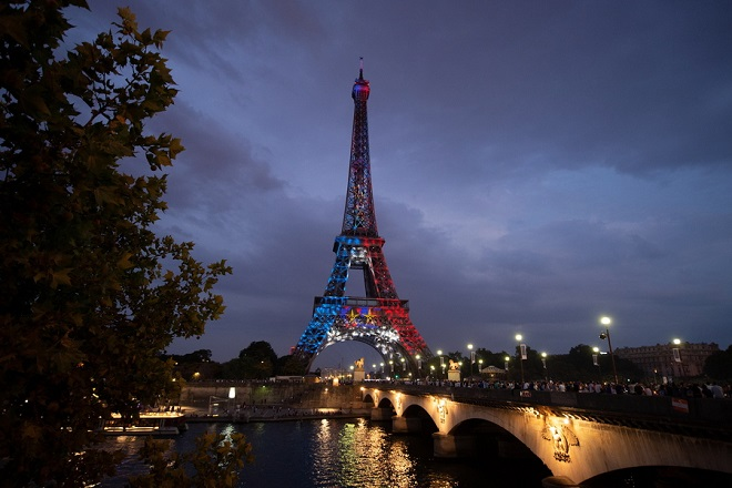 epa06892163 The Eiffel Tower illuminated with blue, white, red is reflected on the surface of the Seine in Paris, after the victory of the French Football Team against Croatia in FIFA World Cup 2018 final soccer match between in Paris, France, 15 July 2018.  EPA/CAROLINE BLUMBERG