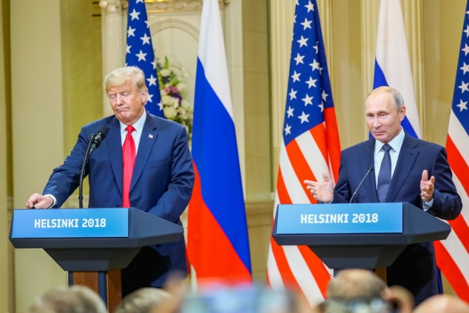 epa06893196 US President Donald J. Trump (L) and Russian President Vladimir Putin (R) hold a joint press conference following their summit talks at the Presidential Palace in Helsinki, Finland, 16 July 2018.  EPA/MAURI RATILAINEN