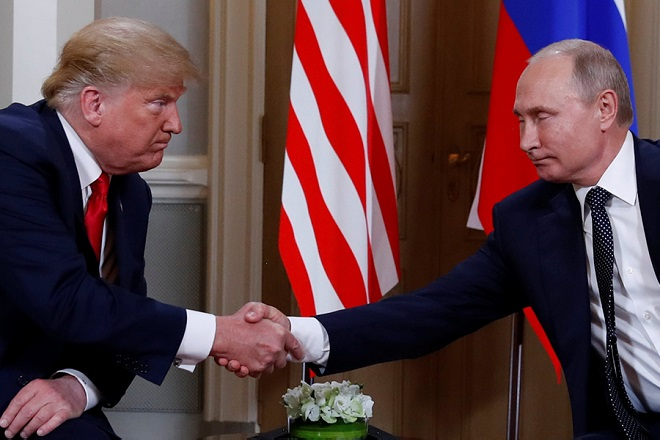 U.S. President Donald Trump and Russia's President Vladimir Putin shake hands as they meet in Helsinki, Finland July 16, 2018. REUTERS/Kevin Lamarque