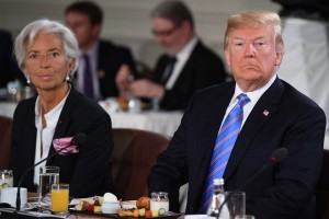 epa06796202 Managing Director of the International Monetary Fund Christine Lagarde (L) and US President Donald J. Trump (R) attend the G7 and Gender Equality Advisory Council Breakfast at the G7 summit in Charlevoix in Canada 09 June 2018. The G7 Summit runs from 08 to 09 June in Charlevoix, Canada.  EPA/NEIL HALL / POOL