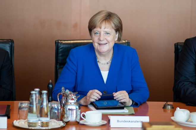 epa06895895 German Chancellor Angela Merkel attends the weekly meeting of the German Federal cabinet, at the Chancellery in Berlin, Germany, 18 July 2018. The weekly meeting was focusing on the withdrawal of Great Britain from the European Union also known as 'Brexit'.  EPA/OMER MESSINGER