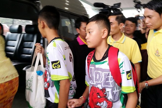 epa06896130 Two of the twelve rescued members of the Wild Boar soccer team depart from the Chiangrai Prachanukroh Hospital in Chiang Rai province, Thailand, 18 July 2018. The 13 members of the Wild Boar child soccer team, including their assistant coach, who were trapped in the Tham Luang cave since 23 June 2018, will make their first appearance for a tightly-controlled interview with media after they were rescued, before returning to their homes with families.  EPA/CHAICHAN CHAIMUN