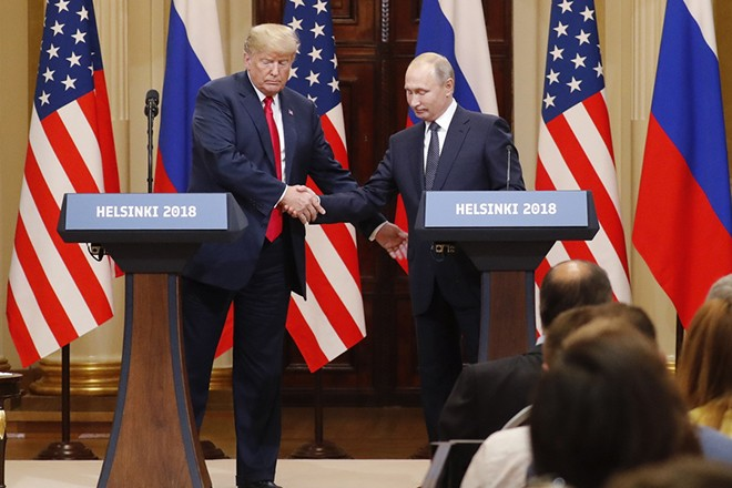 epa06893445 US President Donald J. Trump (L) and Russian President Vladimir Putin (R) during a joint press conference following their summit talks at the Presidential Palace in Helsinki, Finland, 16 July 2018.  EPA/ANATOLY MALTSEV