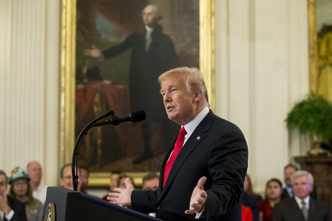 epa06898899 US President Donald J. Trump delivers remarks in front of a portrait of George Washington, during an event entitled 'Pledge to America's Workers', in Washington, DC, USA, 19 July 2018. Trump signed an executive order establishing a 'National Council for the American Worker', an interagency consisting of Trump administration officials that was created to focus on workforce issues.  EPA/MICHAEL REYNOLDS