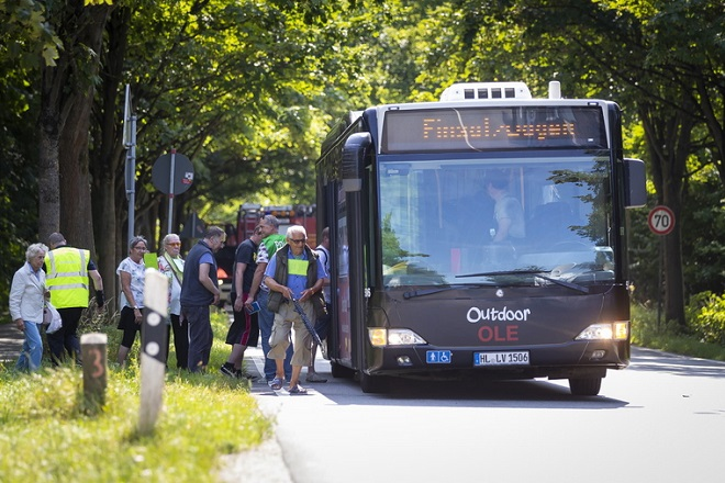 epa06900515 Passengers get onto a replacement bus after a person had allegedly attacked passengers on another bus in Luebeck, Germany, 20 July 2018. According to police reports, several people were injured in a violent incident in a bus in Luebeck Kuecknitz. The perpetrator has been arrested, police said.  EPA/FELIX KOENIG