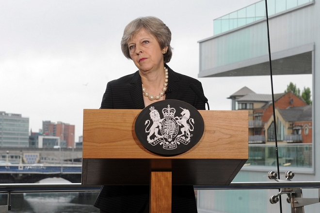 epa06899926 British Prime Minister Theresa May, pauses as she delivers a speech in Belfast, Northern Ireland, 20 July 2018. Reports state that avoiding customs checks at the Northern Ireland border with Ireland is the most critical issue that's holding up Brexit negotiations between the EU and Britain. May has spent months trying to coax her divided cabinet, the House of Commons and peers into unifying behind proposals to keep the border open.  EPA/AIDAN CRAWLEY / POOL
