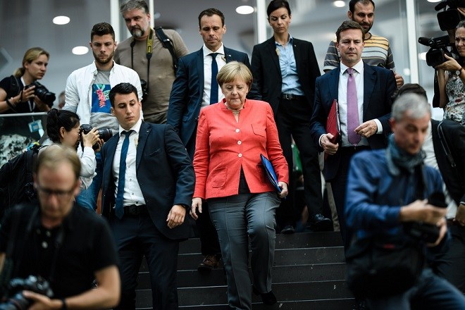 epaselect epa06899972 German Chancellor Angela Merkel leaves after her annual press conference at 'Bundespressekonferenz' in Berlin, Germany, 20 July 2018. The traditional media briefing usually takes place during summer time.  EPA/CLEMENS BILAN