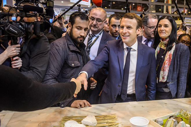 epa06897632 (FILE) - The then French presidential candidate Emmanuel Macron (2-R) of the 'En Marche' political movement flanked by security staff Alexandre Benalla (C) visiting the International Agriculture Fair in Paris, France, 01 March 2017 (reissued 19 July 2018). A video has been released on 19 July 2018 showing Alexandre Benalla, French President Emmanuel Macron's deputy chief of staff, wearing a riot helmet and police uniform, allegedly attacking protesters during street demonstrations on 01 May 2018.  EPA/CHRISTOPHE PETIT TESSON