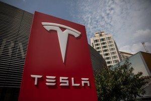 epa06909211 A Tesla sign is seen near Tesla China headquarters in Beijing, China, 25 July 2018. Despite the ongoing trade war between the USA and China, Tesla chief executive Elon Musk earlier this month announced the deal with Chinese authorities to build a new electric car production plant in Shanghai, which will be the first outside the USA. The new auto plant plans to produce 500,000 cars a year.  EPA/ROMAN PILIPEY