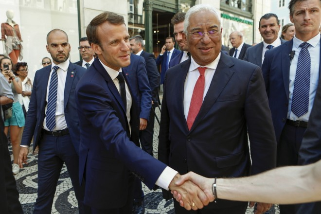 epa06913873 The Portuguese Prime-Minister Antonio Costa (C), and French President Emmanuel Macron (2-L) during a walk about with Portuguese Prime-Minister Antonio Costa through the center of Lisbon, Portugal, 27 July 2018. Macron is on a one day visit to Portugal with the purpose of signing a deal about electric energy interconnections between the Iberian Peninsula and the rest of Europe.  EPA/ANTONIO PEDRO SANTOS