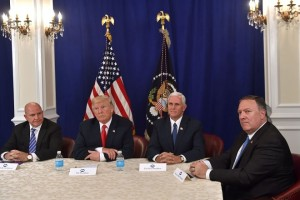 US President Donald Trump, with National Security Advisor H. R. McMaster (L), Vice President Mike Pence (2nd R) and CIA Director Mike Pompeo (R), speaks during a security briefing on August 10, 2017, at his Bedminster National Golf Club in New Jersey.  / AFP PHOTO / Nicholas Kamm        (Photo credit should read NICHOLAS KAMM/AFP/Getty Images)