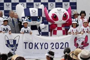 epaselect epa06903680 Tokyo 2020 Olympics mascot Miraitowa (C-L) and Paralympics mascot Someity (C-R) debut in Tokyo, Japan, 22 July 2018 as Yoshiko Mori (L), President of Tokyo 2020 Olympic Committee, and Yuriko Koike (R), Governor of Tokyo, unveil the mascots. Tokyo 2020 Olympics will start on 24 July 2020 through 09 August 2020.  EPA/KIMIMASA MAYAMA