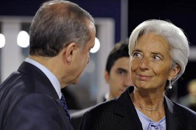 International Monetary Fund (IMF) President Christine Lagarde (R) speaks with Turkey's Prime Minister Recep Tayyip Erdogan before a meeting on the second day of the G20 Summit in Cannes November 4, 2011.      REUTERS/Dylan Martinez (FRANCE  - Tags: POLITICS BUSINESS)