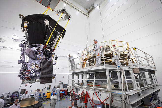 epa06940858 A handout image made available by NASA on 09 August 2018, showing NASA's Parker Solar Probe bejing lifted to the third stage rocket motor on 11 July 2018, at Astrotech Space Operations in Titusville, Florida. In addition to using the largest operational launch vehicle, the Delta IV Heavy, Parker Solar Probe will use a third stage rocket to gain the speed needed to reach the Sun, which takes 55 times more energy than reaching Mars. The Parker Solar probe is due to lift off from Cape Canaveral Air Force Station in Florida for NASA's historic mission to the Sun on 11 August 2018. The probe that will be the fastest spacecraft in history is expected to have a lifetime of some seven years, and is to complete 24 orbits around the sun at a  distance of 3.8 million miles at its closest approach.  EPA/NASA/Johns Hopkins APL/Ed Whitman HANDOUT  HANDOUT EDITORIAL USE ONLY/NO SALES