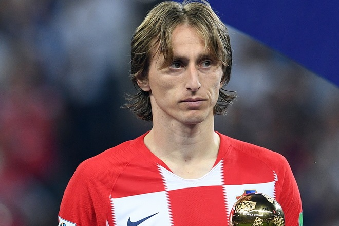 epa06891758 Luka Modric of Croatia reacts after receiving the Best Player award following the FIFA World Cup 2018 final between France and Croatia in Moscow, Russia, 15 July 2018.    (RESTRICTIONS APPLY: Editorial Use Only, not used in association with any commercial entity - Images must not be used in any form of alert service or push service of any kind including via mobile alert services, downloads to mobile devices or MMS messaging - Images must appear as still images and must not emulate match action video footage - No alteration is made to, and no text or image is superimposed over, any published image which: (a) intentionally obscures or removes a sponsor identification image; or (b) adds or overlays the commercial identification of any third party which is not officially associated with the FIFA World Cup)  EPA/FACUNDO ARRIZABALAGA   EDITORIAL USE ONLY