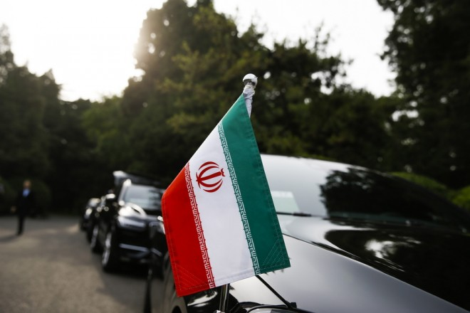epa06732558 Cars of the Iranian delegation are parked outside a building of the at Diaoyutai state guesthouse as Iranian Foreign Minister Mohammad Javad Zarif meets Chinese State Councillor and Foreign Minister Wang Yi, in Beijing, China, 13 May 2018.  EPA/THOMAS PETER / POOL
