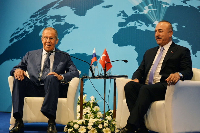 epa06948658 Turkish Foreign Minister Mevlut Cavusoglu (R) speaks with Russian Foreign Minister Sergei Lavrov (L) during their meeting at the 10th Ambassador Conference in Ankara, Turkey, 14 August 2018. The Conference takes place under the topic 'Enterprising and Humanitarian Foreign Policy in the Presidential System of Government'.  EPA/STR