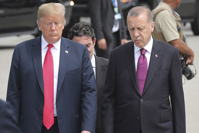 epa06943394 (FILE) - US President Donald J. Trump (L) and Turkey's President Recep Tayyip Erdogan (R) arrive for a family picture of Nato Summit in Brussels, Belgium, 11 July 2018 (reissued 11 August 2018). Turkish President Erdogan condemned US President Trump's doubling of tariffs on Turkish steel and aluminium imports up to 50 percent. The Turkish lira plunged over 20 percent against the US dollar after Trump's announcement on 10 August 2018, which has been exacerbated over the disputed imprisonment of US pastor Andrew Brunson in Turkey.  EPA/OLIVIER HOSLET