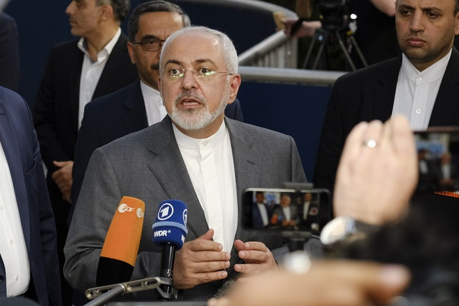 epa06739667 Iran's Foreign Minister Mohammad Javad Zarif arrives at a meeting on Iran Nuclear Deal, in Brussels, Belgium, 15 May 2018. EU High Representative Federica Mogherini convened a meeting with the E3 Foreign Ministers, followed by a meeting of the four with the Foreign Minister of Iran, Mohammad Javad Zarif.  EPA/OLIVIER HOSLET