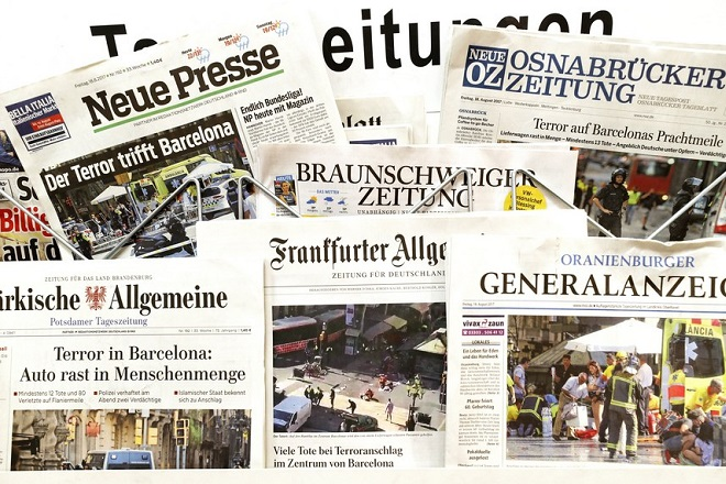 epa06150071 A collection of German daily newspapers with their fornt page articles of the 17 August terror attacks in Spain is available at a newspaper stand in Berlin, Germany, 18 August 2017. According to media reports, at least 14 people were killed and some 130 others injured after cars crashed into pedestrians on the Las Ramblas boulevard in Barcelona and on a promenade in the coastal city of Cambrils. Spanish police have stated that the attacks in Barcelona and in Cambrils were linked. The so-called 'Islamic State' (IS) has claimed responsibility for the attack in Barcelona.  EPA/FELIPE TRUEBA
