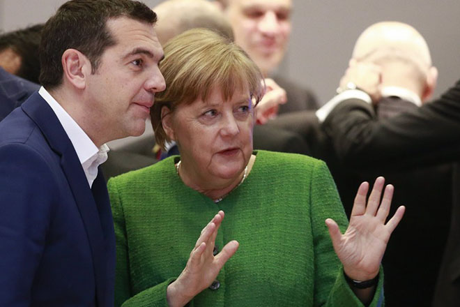 epa06557572 German Chancellor Angela Merkel and Greek Prime Minister Alexis Tsipras (L) prior to the Informal meeting of the 27 European Heads of States of Governments in Brussels, Belgium, 23 February 2018. The 27 European Heads of States of Governments will discuss on the new composition of the European Parliament after the so-called 'Brexit' and a post-2020 EU budget for several years.  EPA/OLIVIER HOSLET