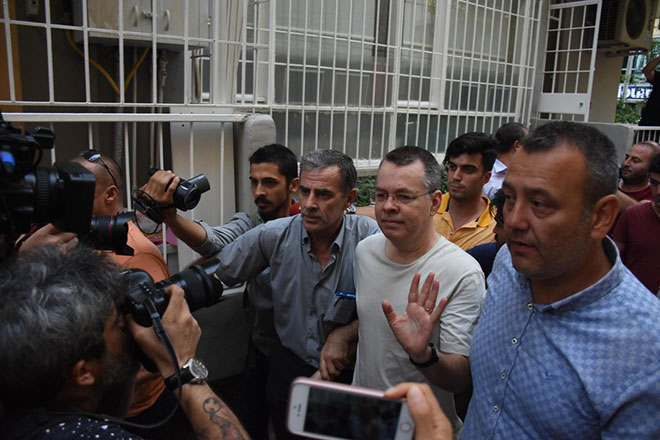 epa06910220 US pastor Andrew Brunson (C) is released from jail and will be put under house arrest during the duration of his trial, at Aliaga Prison in Izmir, Turkey, 25 July 2018. The US pastor has been in custody for two years under terror and espionage charges.  EPA/MUSTAFA KOPRULU