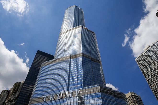 epa06950455 (FILE) - Clouds are reflected in the glass and steel of Trump Tower as it rises above the Chicago River in downtown Chicago, Illinois, USA, 25 April 2016 (reissued 15 August 2018). According to media reports, Illinois' attorney general Lisa Madigan has filed a lawsuit on 14 August 2018, against Chicago's Trump International Hotel & Tower over alleged river pollution, claiming that the property draws and releases water into the Chicago River without necessary permits. Trump Tower officials said that the lawsuit was 'politically motivated,' media added.  EPA/TANNEN MAURY *** Local Caption *** 52722664