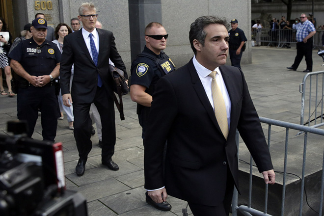 epa06963250 Michael Cohen (R), President Donald Trump's personal attorney leaves following a hearing at United States Federal Court in New York, New York, USA, 21 August 2018. Former attorney for US President Trump, Michael Cohen, pleads guilty to several counts of banking, tax and campaign finance laws violations.  EPA/JASON SZENES