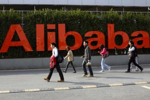 epa06710593 (FILE) - A file photo dated 17 March 2014 showing people walking in the headquarters campus of Alibaba Group, mother company of Chinese e-commerce giants Taobao and Tmall, in Hangzhou, Zhejiang province, China (re-issued 04 May 2018). Alibaba on 04 May 2018 reported their fiscal year 2018 results, saying their full year revenue grew 58 per cent to 39,898 million USD and core commerce revenue grew 60 per cent, while profit growth reached over 40 per cent and annual free cash flow was at 15.8 billion USD. Alibaba says they expect overall revenue for fiscal year 2019 to grow above 60 per cent.  EPA/CRAB HU