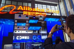 epa06769353 A man takes picture of Alibaba Group booth on Big Data expo in Guiyang, Guizhou Province, China, 28 May 2018. Big Data Industry Expo 2018 opened in Guiyang, which according to reports shall become the technical support center and Internet Content Provider (ICP) filing center for Alibaba Cloud, the cloud service of Chinese e-commerce giant Alibaba. All websites hosted on the Chinese mainland must be ICP filed with the Ministry of Industry and Information Technology. A website cannot direct to any server located on the Chinese mainland for public visits until the developer get an ICP filing number. Alibaba Cloud will also provide cloud storage service for the research data of China's 500-metres-aperture Spherical Radio Telescope in Guizhou Province, the world's largest single-dish radio telescope.  EPA/Aleksandar Plavevski