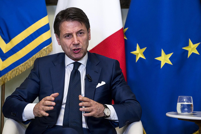 epa06935133 Italian Prime Minister Giuseppe Conte during his press conference at Chigi Palace in Rome, Italy, 08 August 2018. Giuseppe Conte said that his government's 2019 budget will be bold ahead of a meeting with deputy premiers Luigi Di Maio and Matteo Salvini.  EPA/ANGELO CARCONI