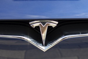 epa06934130 The Tesla logo on the front of a Tesla Model X at the Tesla dealership showroom in Boston, Massachusetts, USA 07 August 2018. Earlier in the day Tesla founder Elon Musk tweeted, 'Am considering taking Tesla private at $420. Funding secured' and a few hours later Musk confirmed his earlier statement on the Tesla website blog.  EPA/CJ GUNTHER