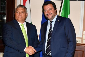 epa06979149 Italian Interior Minister Matteo Salvini (R) shakes hand with Hungarian Prime Minister, Viktor Orban (L), during their meeting at the Prefecture of Milan, Italy, 28 August 2018.  EPA/DANIEL DAL ZENNARO