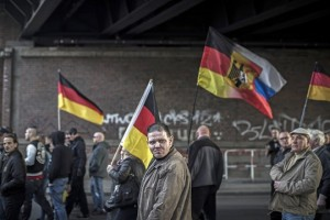 epa05829420 Right-wing activists march during a demonstration in Berlin, Germany, 04 March 2017. Hundreds of people - among them neo-Nazis, supporters of far-right party NPD and supporters of the far-right 'Identitarian movement' - attended the march organised by far-right initiative 'We for Berlin - We for Germany.' It was met by leftist counterprotesters.  EPA/OLIVER WEIKEN