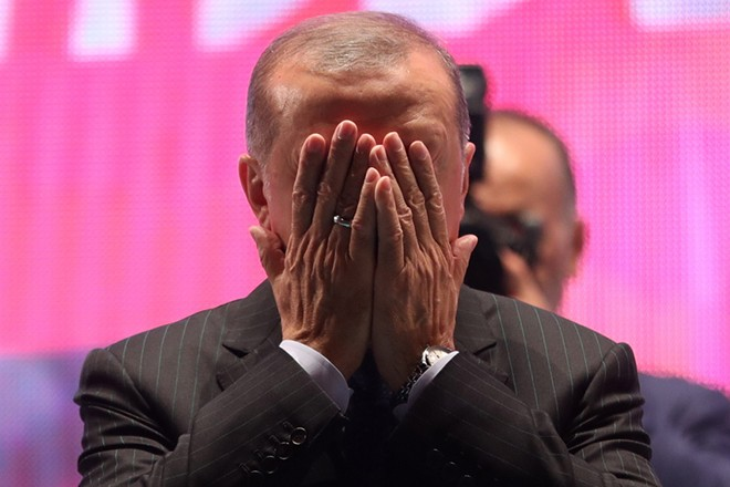 epa06891931 Turkish President Recep Tayyip Erdogan prays during a rally for the second anniversary of the failed coup attempt on Bosphorus Bridge in Istanbul, Turkey, 15 July 2018. The 15 July 2016 events mark the second anniversary of the failed coup attempt which led to some 50,000 workers being dismissed, some 8,000 people arrested, and scores of news outlets shut down by the government. Turkish military factions on 15 July 2016 attempted a coup d'etat, for which Turkish President Recep Tayyip Erdogan was quick to blame US-based Turkish cleric Fetullah Gulen and his movement to allegedly have masterminded the attempt.  EPA/ERDEM SAHIN