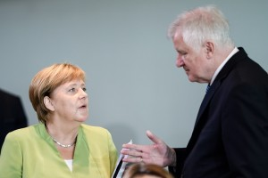 epa06980393 German Chancellor Angela Merkel (L) and German Minister of Interior, Construction and Homeland Horst Seehofer (R) talk at the beginning of the weekly meeting of the German Federal cabinet at the Chancellery in Berlin, Germany, 29 August 2018. The ministers and the Chancellor are expected to discuss, among others, the draft law on the improvement and stabilization of the statutory pension.  EPA/CLEMENS BILAN